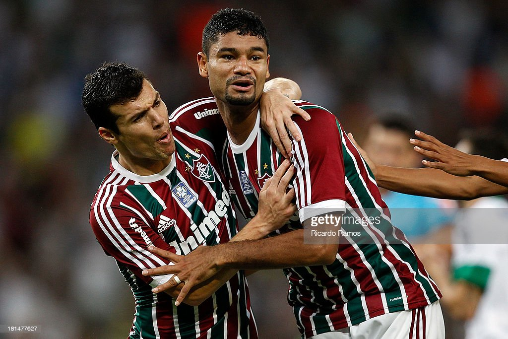 Wagner (R) and Gum of Fluminense celebrate a scored goal during the match between Fluminense and Coritiba for the Brazilian Series A 2013 at Maracana on September 21, 2013 in Rio de Janeiro, Brazil.