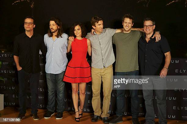 Wagner Mora Diego Luna Alicia Braga Sharlto Coplay Neill Blomkam and Matt Damon pose for photographers during the presentation of Elysium on Aperil...