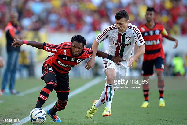 Wagner of Fluminense battles for the ball with Luiz Antonio of Flamengo during the match between Fluminense and Flamengo as part of Brasileirao...