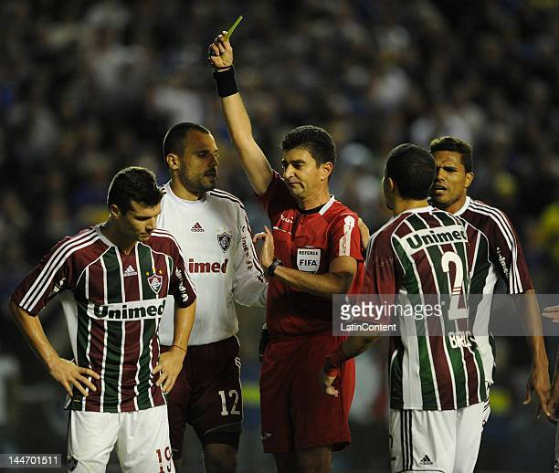 Wagner of Fluminense receives a yellow card during a match as part of the Santander Libertadores Cup at Alberto J Armando Stadium on Mayo 17 2012 in...