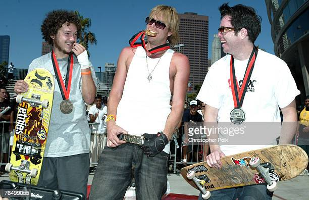 Wagner Ramos, Chad Muska and Rodil de Araujo, Jr. Pose for photographers during the awards ceremony at the X-Games IX - Skateboard Street Best Trick...