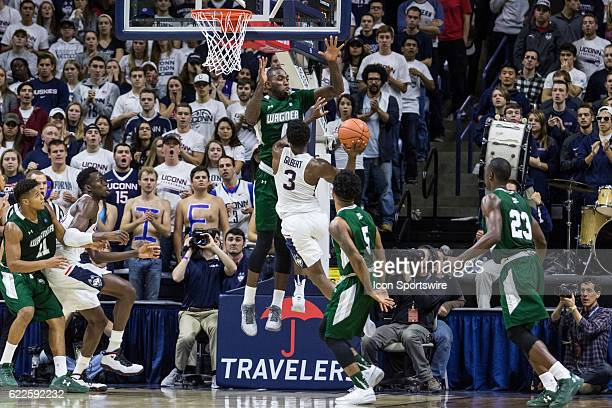 Wagner Seahawks Forward AJ Sumbry blocks a oncoming UConn Huskies Guard Alterique Gilbert during the first half of a men's NCAA division 1 basketball...