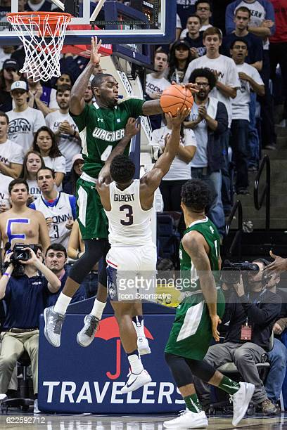 Wagner Seahawks Forward AJ Sumbry blocks a shot by UConn Huskies Guard Alterique Gilbert during the first half of a men's NCAA division 1 basketball...