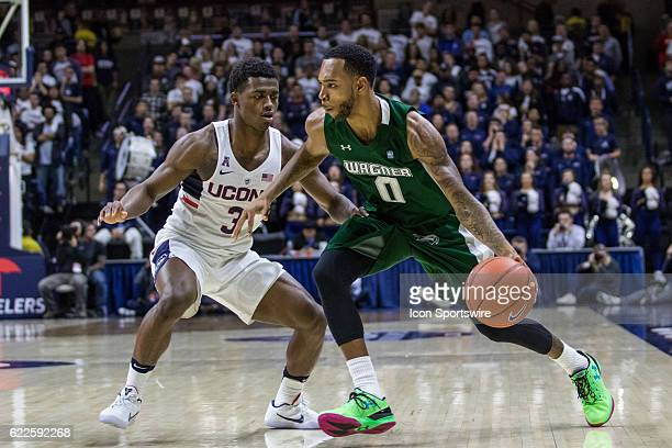 Wagner Seahawks Guard Corey Henson dribbles around UConn Huskies Guard Alterique Gilbert during the first half of a men's NCAA division 1 basketball...