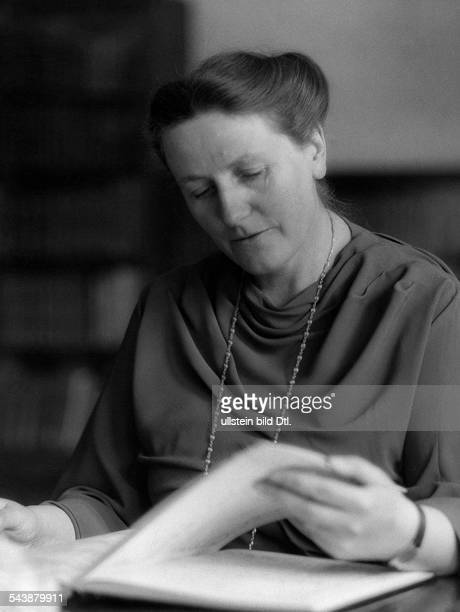 Wagner Winifred England*23061897nee Winifred Marjorie Williams Head of the Bayreuth Festival until 1944 is flipping through in a book Photographer...