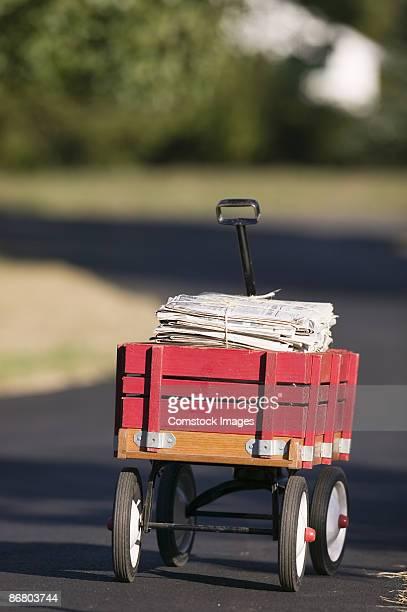 wagon full of newspapers - toy wagon stock photos and pictures