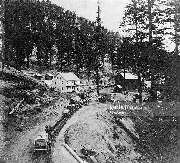 A wagon train arriving at an unspecified Western settlement USA date unknown
