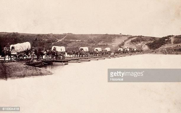 A wagon train crossing the Rappahannock River during the Civil War