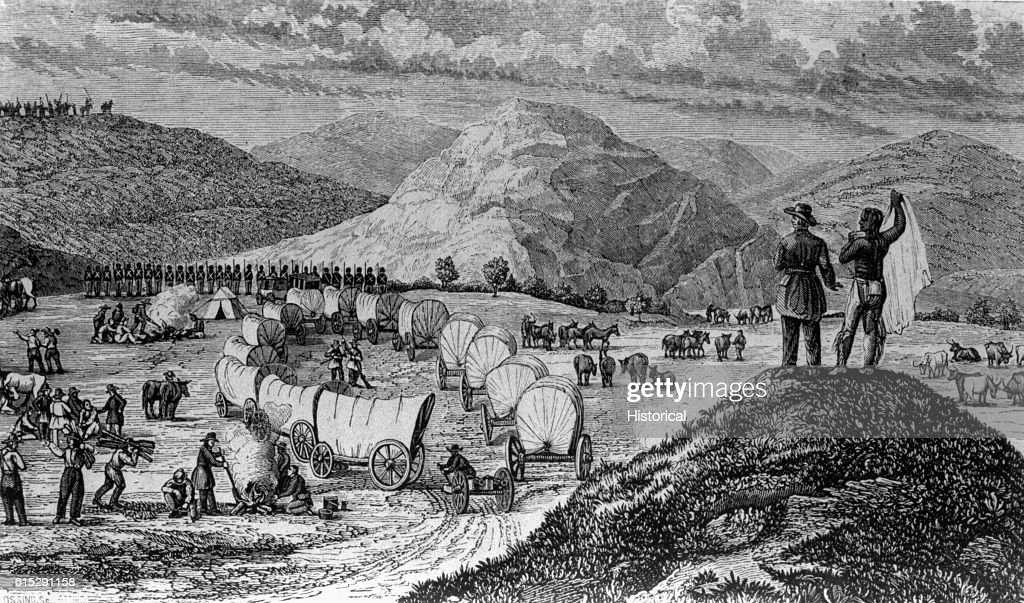 A wagon train of American pioneers make camp for the night as a group of Native American watch from atop a hill. Engraving in Josiah Gregg's Commerce of the Prairies: or the Journal of a Santa Fe Trader . . . 1844.