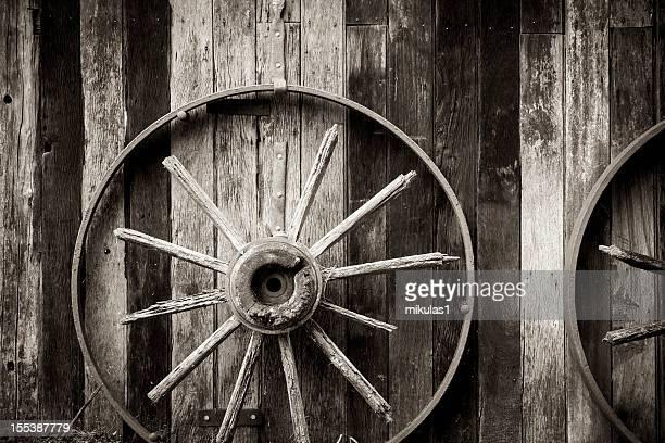Wagon wheel, fence frame background