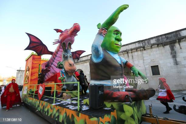 A wagon with statues of Shrek and a dragon during the carnival parade in the ancient city of Capua