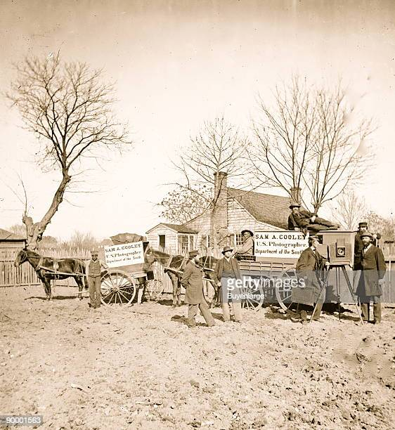 Wagons and camera of Sam A Cooley US photographer with Staff Black Teenager