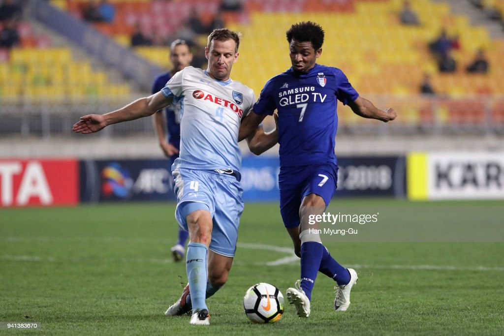 Waguininho of Suwon and Alex Wilkinson of Sydney FC compete for the ball during the AFC Champions League Group H match between Suwon Samsung Bluewings and Sydney FC at Suwon World Cup Stadium on April 3, 2018 in Suwon, South Korea.