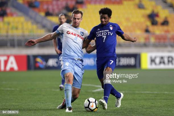 Waguininho of Suwon and Alex Wilkinson of Sydney FC compete for the ball during the AFC Champions League Group H match between Suwon Samsung...
