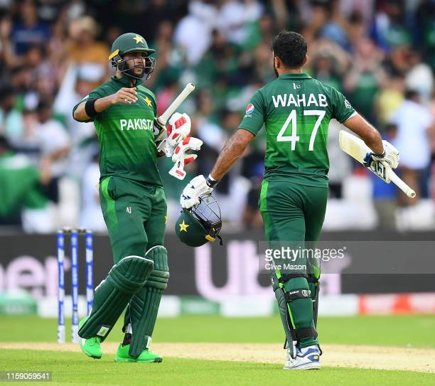 Wahab Riaz and Imad Wasim of Pakistan celebrate the win after the Group Stage match of the ICC Cricket World Cup 2019 between Pakistan and...