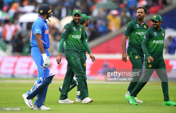 Wahab Riaz Mohammad Amir and Babar Azam of Pakistan leave the field as rain stops play during the Group Stage match of the ICC Cricket World Cup 2019...
