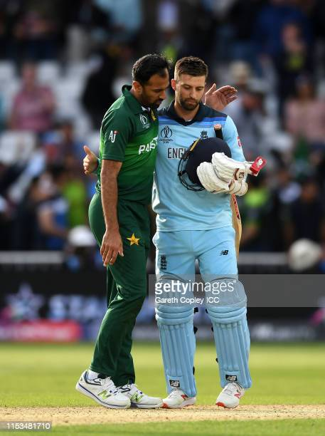 Wahab Riaz of Pakistan and Mark Wood of England embrace at the end of the match during the Group Stage match of the ICC Cricket World Cup 2019...