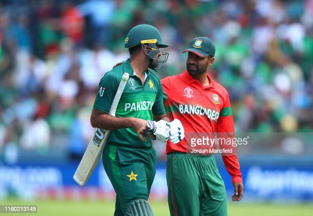 Wahab Riaz of Pakistan and Tamim Iqbal of Bangladesh speak during the Group Stage match of the ICC Cricket World Cup 2019 between Pakistan and...