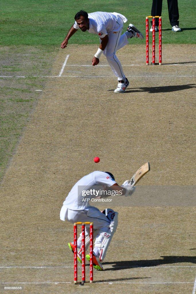 Wahab Riaz of Pakistan bowls on Dinesh Chandimal of Sri Lanka during the second day of the second Test cricket match between Sri Lanka and Pakistan at Dubai International Stadium in Dubai on October 7, 2017. /
