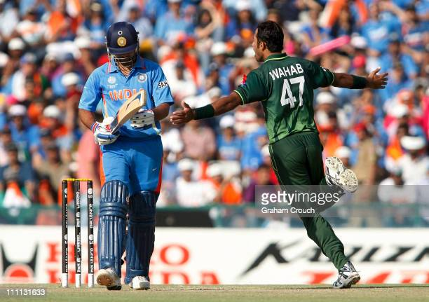 Wahab Riaz of Pakistan celebrates after having Virat Kohli of India caught by Umar Akmal during the 2011 ICC World Cup second SemiFinal between...