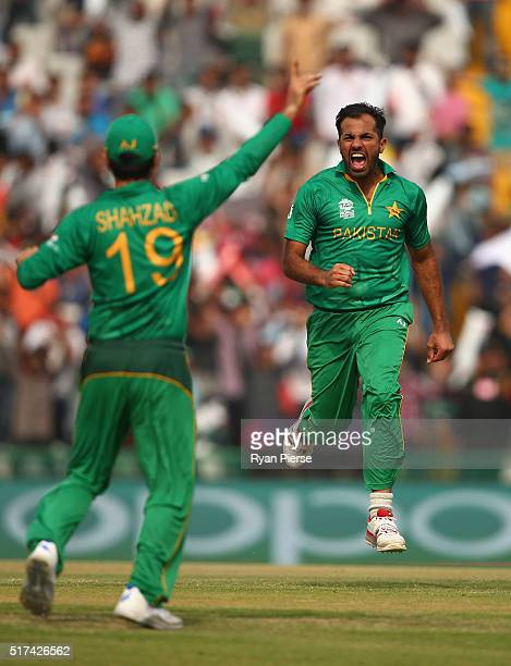 Wahab Riaz of Pakistan celebrates after taking the wicket of David Warner of Australia during the ICC WT20 India Group 2 match between Pakistan and...