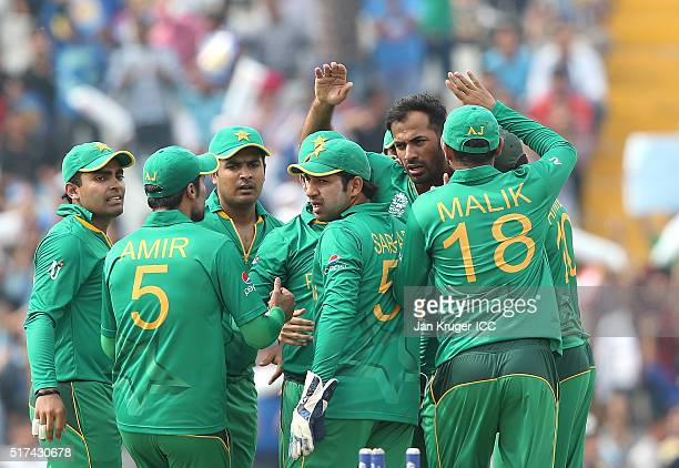 Wahab Riaz of Pakistan celebrates the wicket of David Warner of Australia with team mates during the ICC World Twenty20 India 2016 Super 10s Group 2...