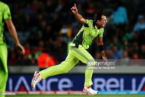 Wahab Riaz of Pakistan celebrates the wicket of Mohammad Imran Tahir of South Africa to win the match during the 2015 ICC Cricket World Cup match...