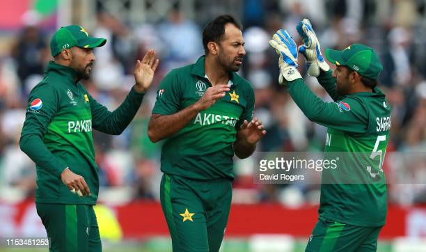 Wahab Riaz of Pakistan celebrates with his captain Sarfaraz Ahmed after taking the wicket of Chris Woakes during the Group Stage match of the ICC...