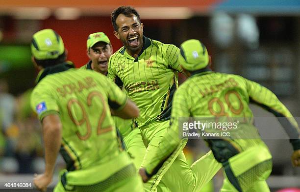 Wahab Riaz of Pakistan celebrates with team mates after taking the wicket of Tewanda Mupariwa of Zimbabwe during the 2015 ICC Cricket World Cup match...