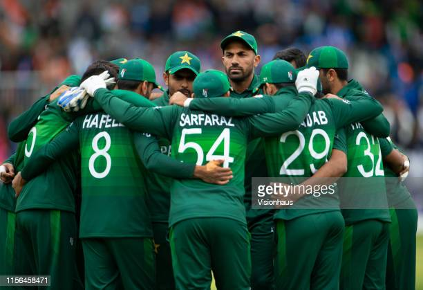 Wahab Riaz of Pakistan joins in with the team huddle during the Group Stage match of the ICC Cricket World Cup 2019 between Pakistan and India at Old...