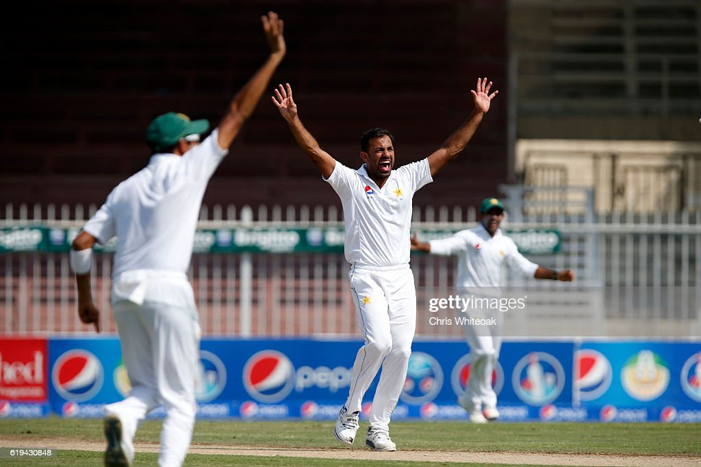 Wahab Riaz of Pakistan takes the wicket of Leon Johnson of West Indies on day two of the third test between Pakistan and West Indies at Sharjah Cricket Stadium on October 31, 2016 in Sharjah, United Arab Emirates.