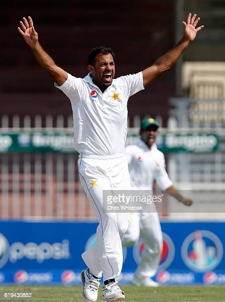 Wahab Riaz of Pakistan takes the wicket of Leon Johnson of West Indies on day two of the third test between Pakistan and West Indies at Sharjah...