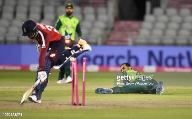 Wahab Riaz of Pakistan watches as he runs out Chris Jordan of England during the 3rd Vitality Twenty20 match at Emirates Old Trafford on September...