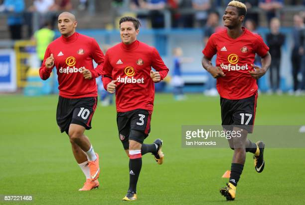 Wahbi Khazri Bryan Oviedo and Didier N'Dong of Sunderland warm up during the Carabao Cup 2nd round match between Carlisle United and Sunderland at...