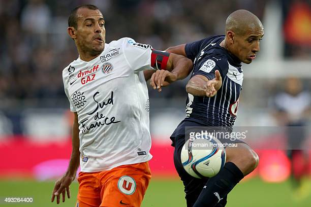 Wahbi Khazri for FC Girondins de Bordeaux and Vitorino Hilton for Montpellier Heralut SC battle for the ball during the French Ligue 1 game between...