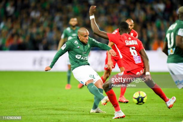 Wahbi Khazri of Saint Etienne and Junior Sambia of Montpellier during the Ligue 1 match between Saint Etienne and Montpellier on May 10 2019 in Saint...
