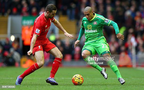 Wahbi Khazri of Sunderland and Jordan Henderson of Liverpool compete for the ball during the Barclays Premier League match between Liverpool and...