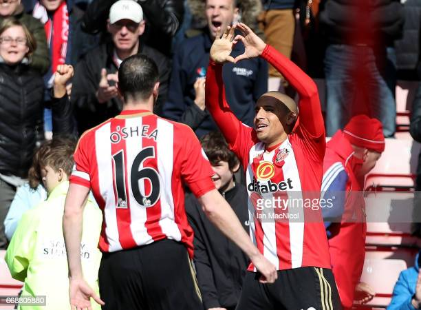 Wahbi Khazri of Sunderland celebrates scoring his sides first goal with John O'Shea of Sunderland during the Premier League match between Sunderland...