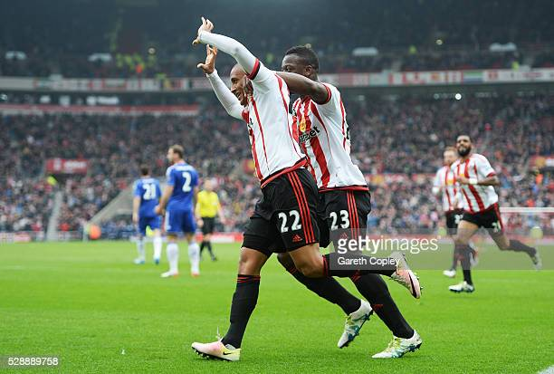 Wahbi Khazri of Sunderland celebrates scoring his team's first goal with his team mate Lamine Kone during the Barclays Premier League match between...