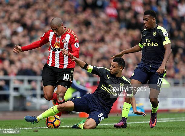 Wahbi Khazri of Sunderland is tackled by Francis Coquelin of Arsenal during the Premier League match between Sunderland and Arsenal at the Stadium of...