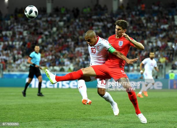 Wahbi Khazri of Tunisia and John Stones of England battle for the ball during the 2018 FIFA World Cup Russia group G match between Tunisia and...