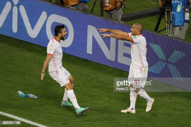 Wahbi Khazri of Tunisia celebrates with teammate Oussama Haddadi after scoring his team's second goal during the 2018 FIFA World Cup Russia group G...