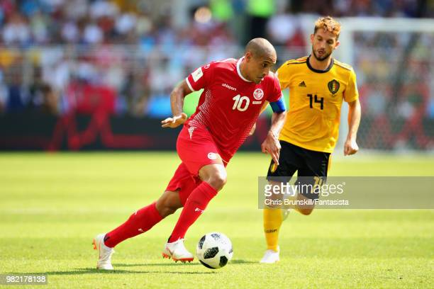 Wahbi Khazri of Tunisia is chased down by Dries Mertens of Belgium during the 2018 FIFA World Cup Russia group G match between Belgium and Tunisia at...
