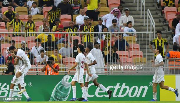 Wahda players celebrate their goal during the AFC Champions League group B football match between Saudi's Al Ittihad and UAE's Al Wahda at the King...