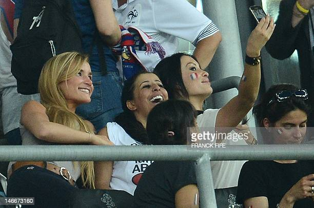Wahiba Ribery wife of Franck Ribery and Sidonie Biemont girlfriend of Adil Rami pose for a photo before the Euro 2012 football championships match...