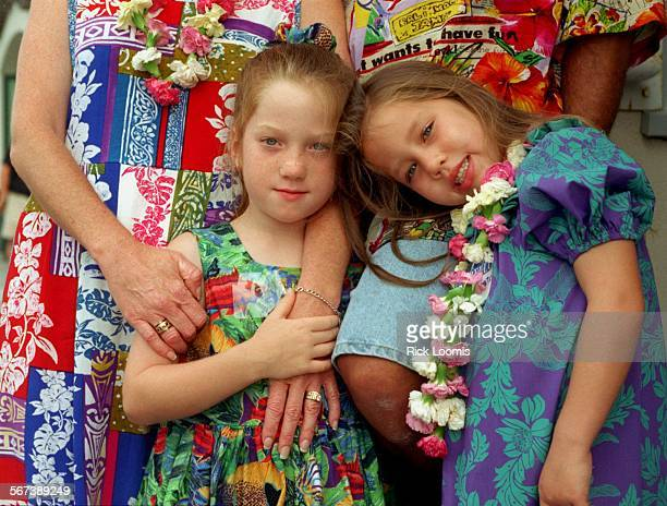 LSWahine#10731RL–KODAK J–Huntington Beach– Chantal and Celeste along with their parents Cynthia and Gustavo Mosqueda wear brightly colored clothing...