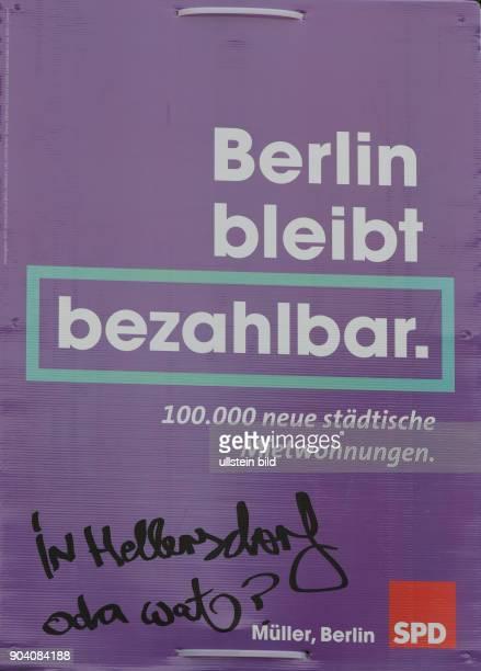 Wahlplakt der SPD mit dem Slogan BERLIN BLEIBT BEZAHLBAR und der Erwiderung IN HERSDORF ODA WAT in BerlinPrenzlauer Berg