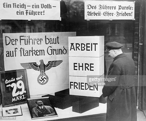 Wahlpropaganda im Schaufenster einesBerliner Handwerksbetriebes März 1936