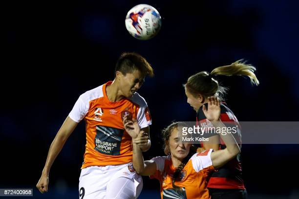 Wai Ki Cheung and Abbey Lloyd of the Roar compete for the ball with Maruschka Waldus of the Wanderers during the round three WLeague match between...