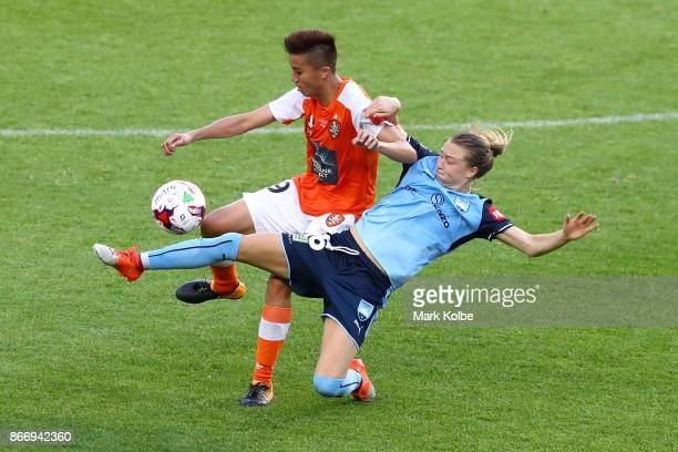 Wai Ki Cheung of the Roar and Emily Sonnett of Sydney FC compete for the ball during the round one WLeague match between Sydney FC and the Brisbane...